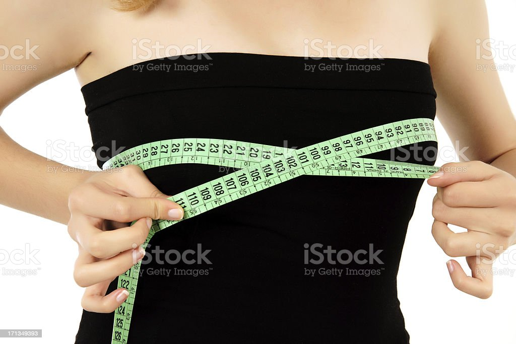 young woman is measuring her breast (XXXL) stock photo