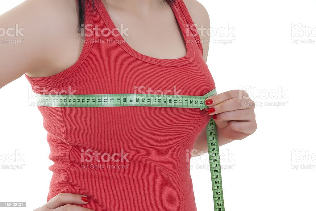 young woman is measuring her breast stock photo
