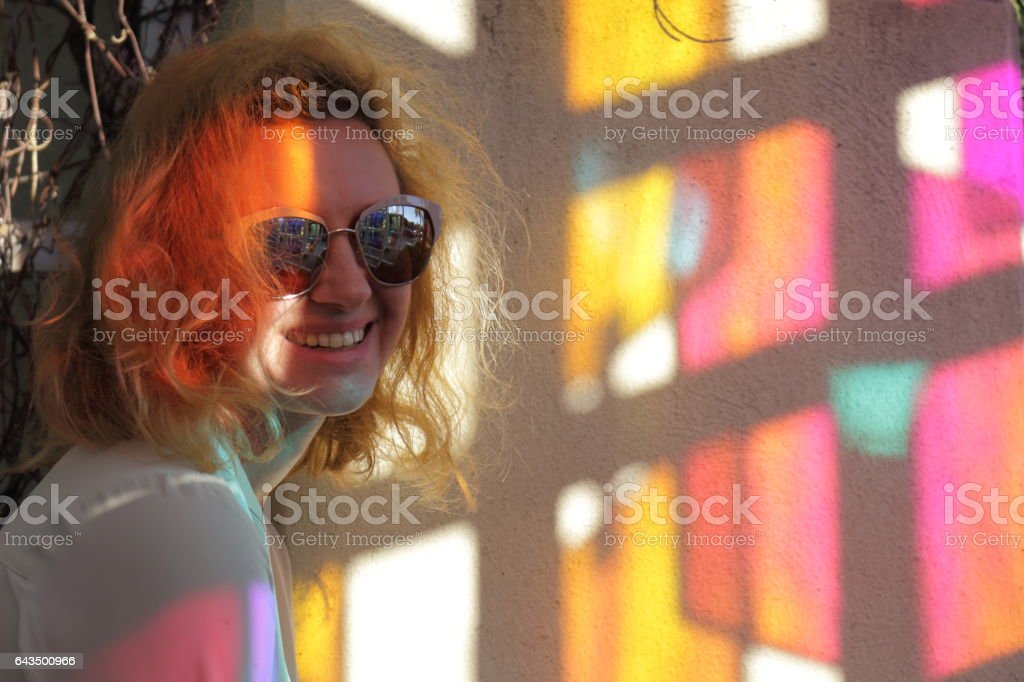 Young woman is neat color kaleidoscope hotspots. stock photo