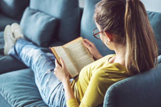 Young woman is reading book stock photo
