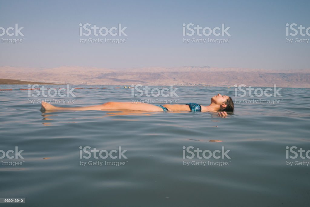 young woman is relaxing in dead sea royalty-free stock photo
