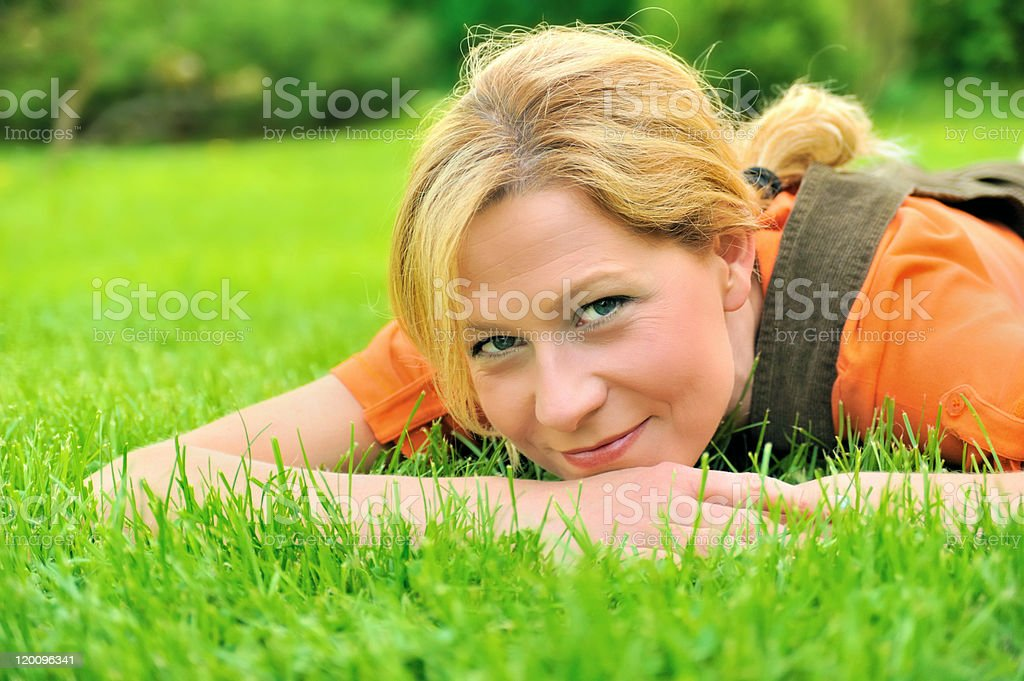 Young woman is relaxing on the grass royalty-free stock photo