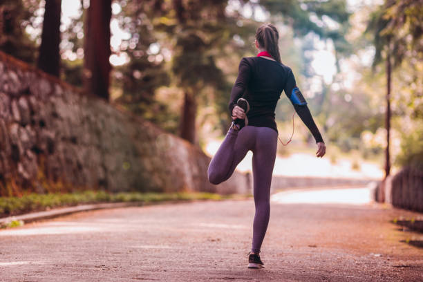 Young woman is running Young woman is running women's track stock pictures, royalty-free photos & images