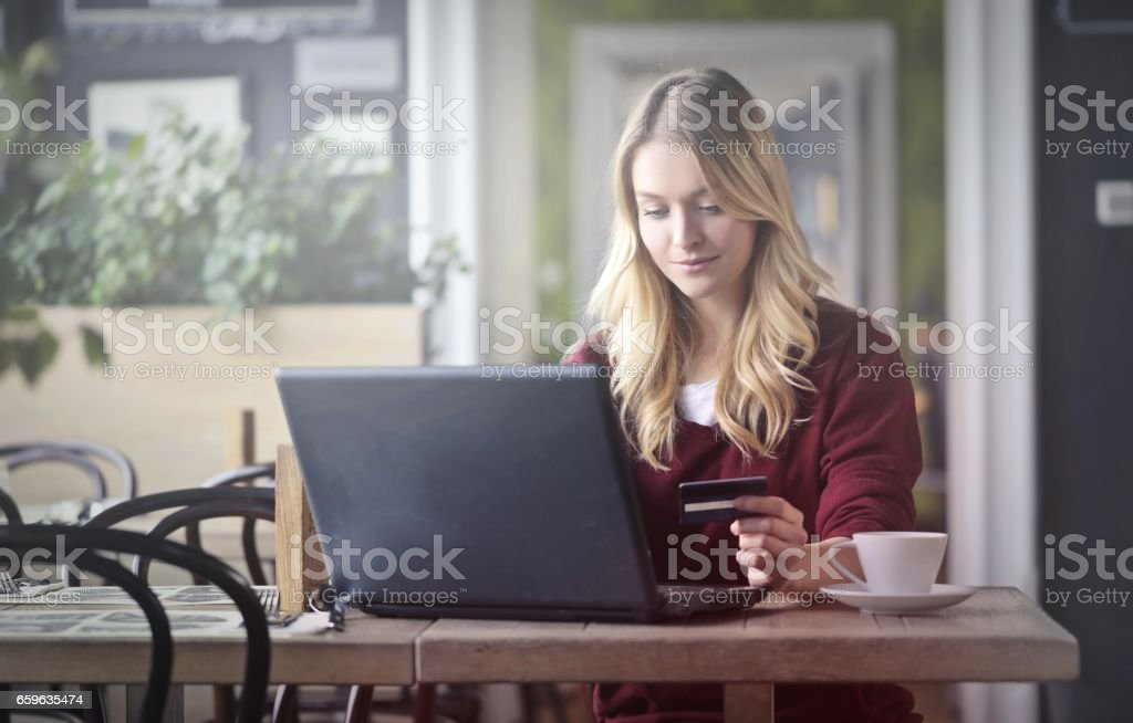 Young woman is shopping online stock photo