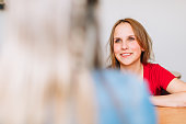 istock A young woman is smiling and listening at a social worker 962234108
