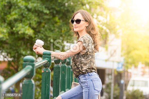 Portrait of a girl posing on city street