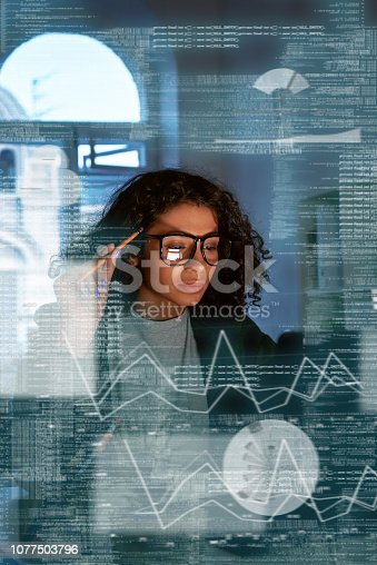 Young woman is thinking about the statistics and graphics. She holding pencil