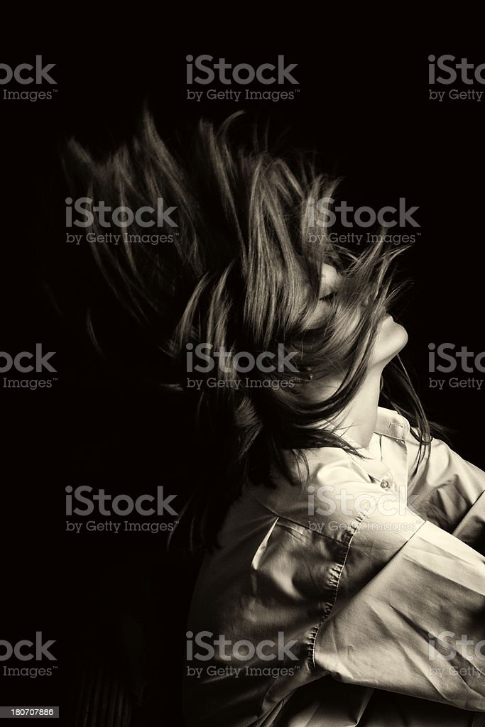 young woman is tossing her hair stock photo