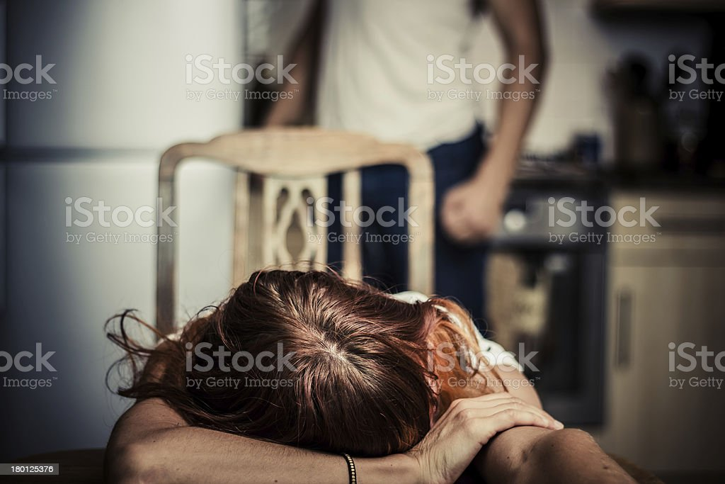 Young woman is victim of domestic abuse stock photo