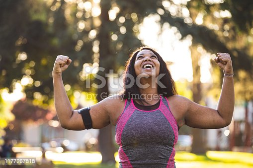 Young woman jogging and getting healthy at the park