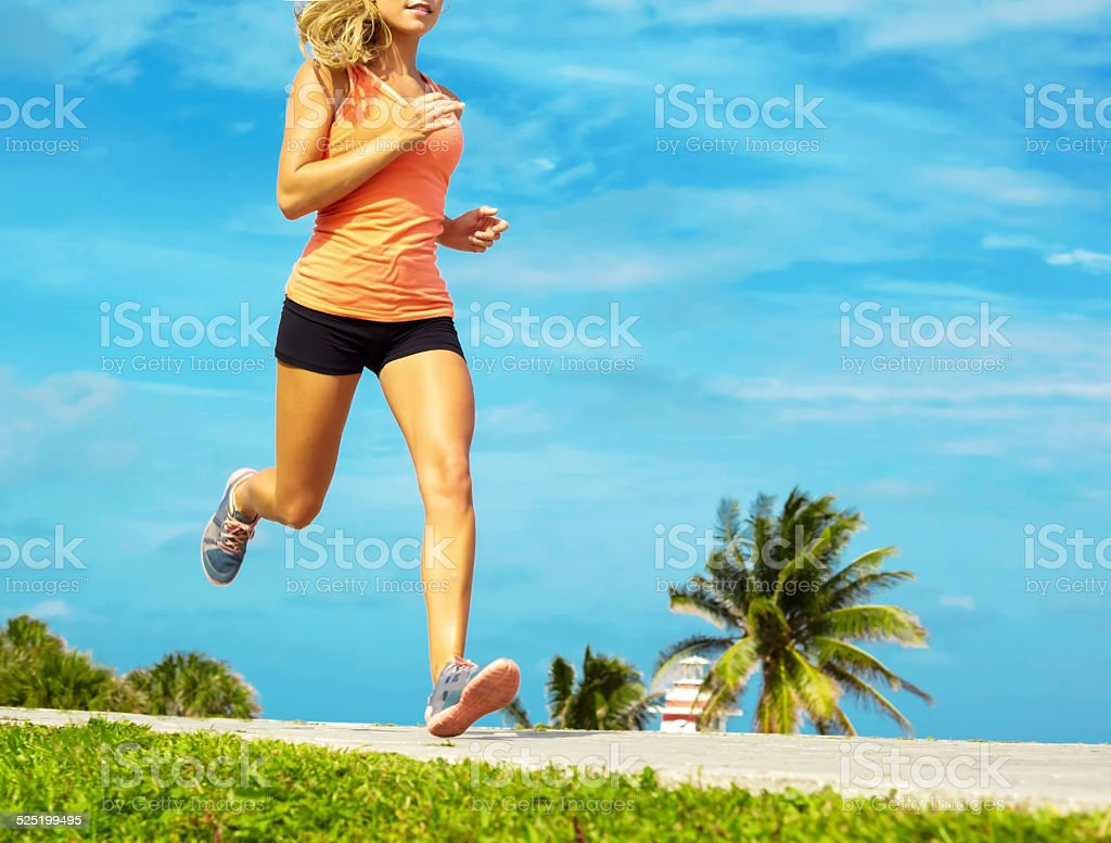 Young Woman Jogging At Beach stock photo