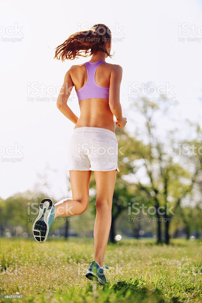 Young woman jogging in nature stock photo