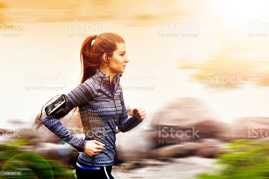 Young woman jogging in Tokyo, Japan stock photo