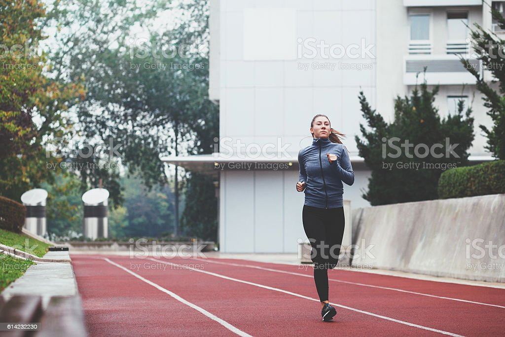 Young woman jogging on a cold day stock photo