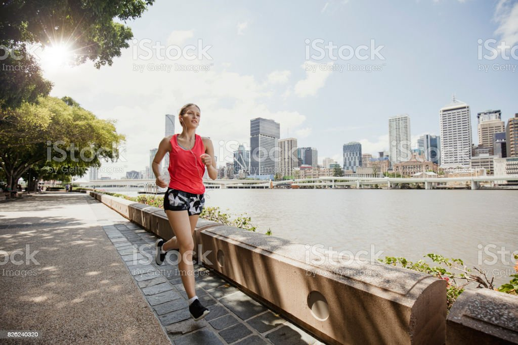 Young Woman Jogging on Brisbane Southbank stock photo