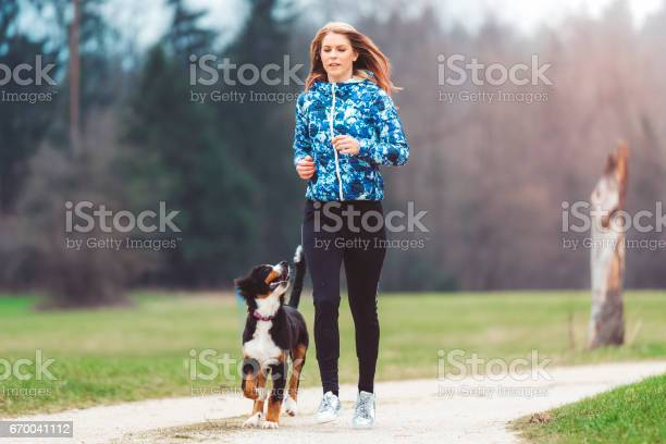 Young woman jogging with dog picture id670041112?b=1&k=6&m=670041112&s=612x612&h= 8haahy0f7dwldgrwqdj2sovvhw2dbkecwjl0fcct5w=