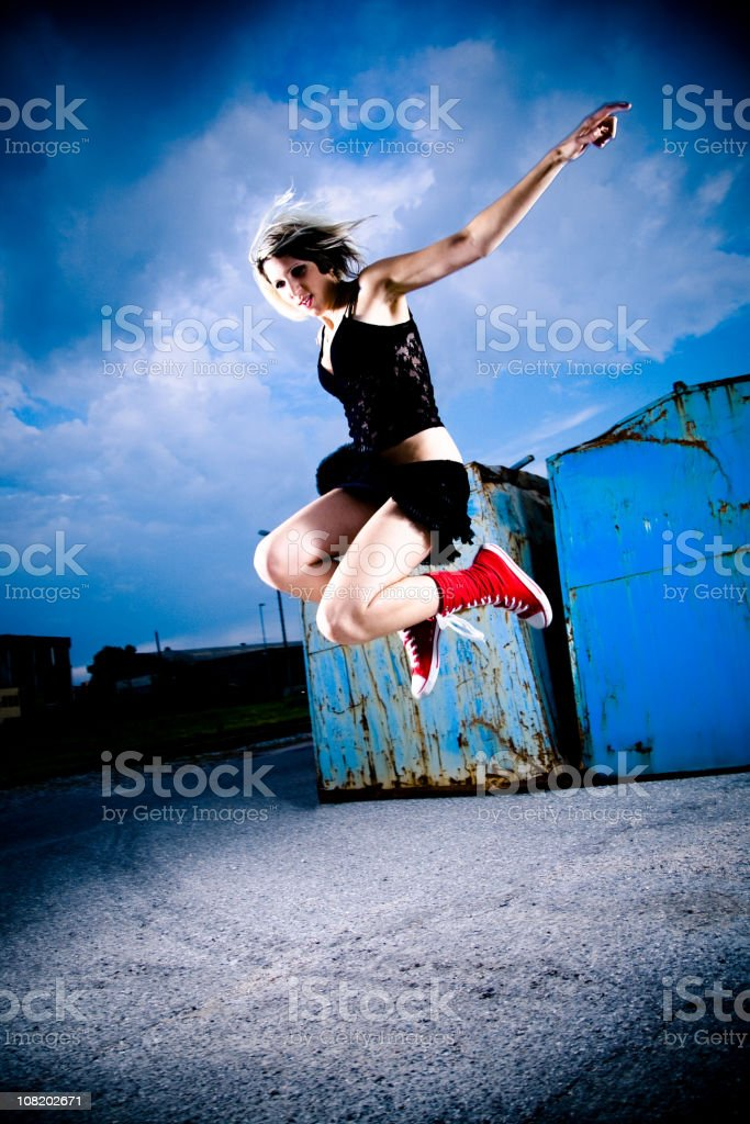 Young Woman Jumping High in Air royalty-free stock photo
