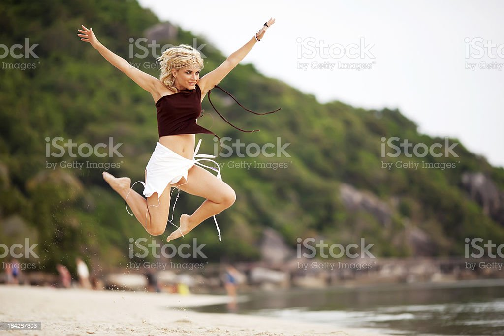 Young Woman Jumping High In The Sky Stock Photo - Download