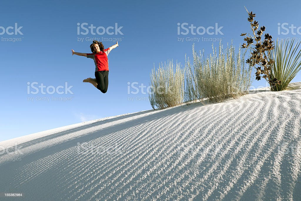 Young Woman Jumping in White Sands National Monument USA royalty-free stock photo