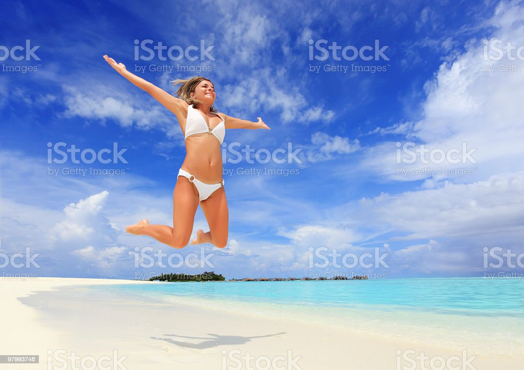 Young woman jumping on the tropical beach. royalty-free stock photo