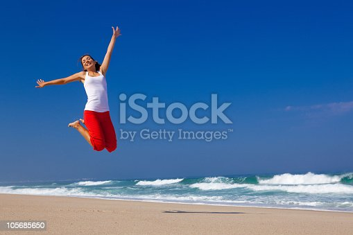 istock Young woman jumping 105685650