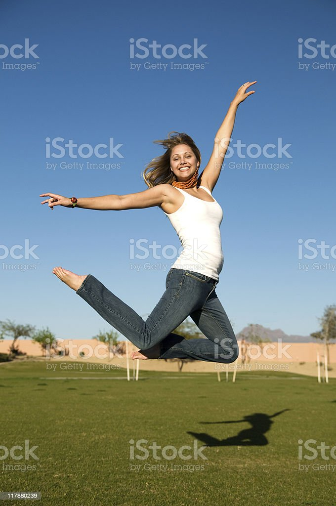 Young woman jumping royalty-free stock photo