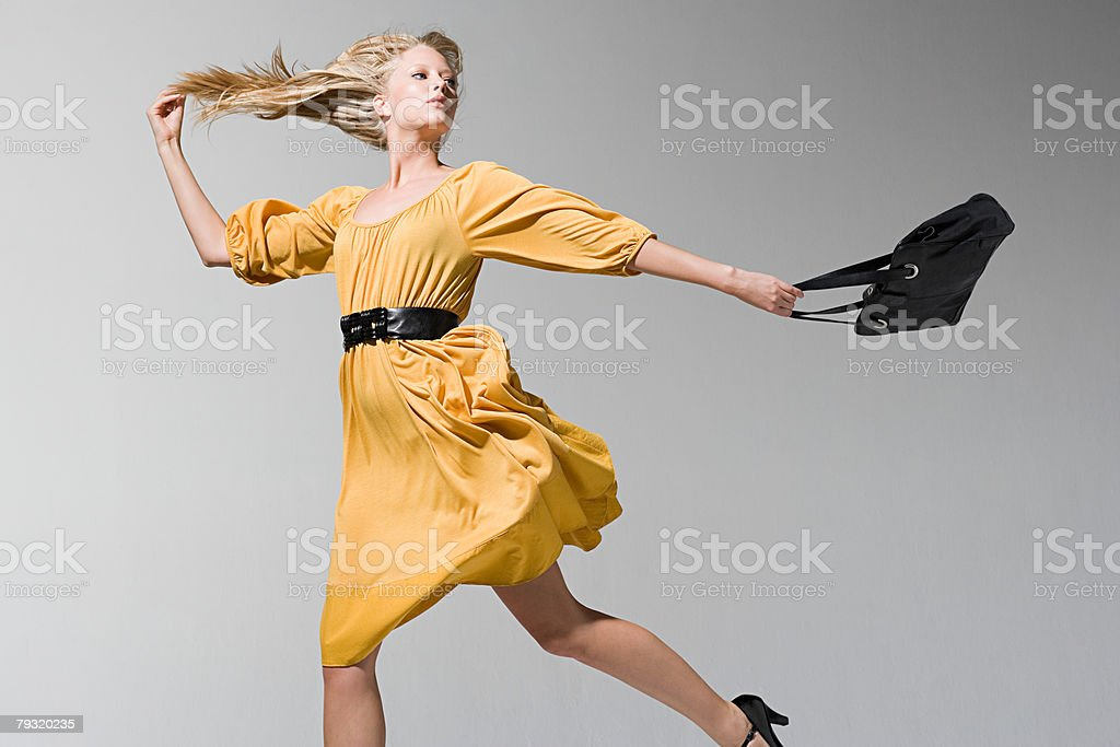 A young woman jumping royalty-free 스톡 사진