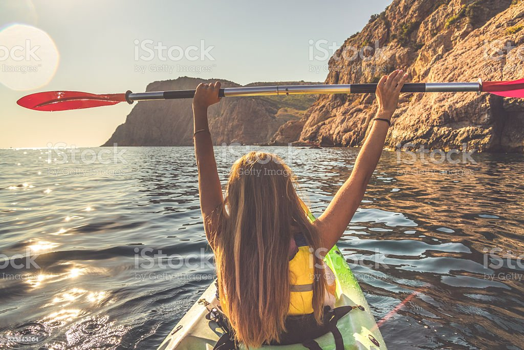 Young Woman Kayaking in the Sea stock photo