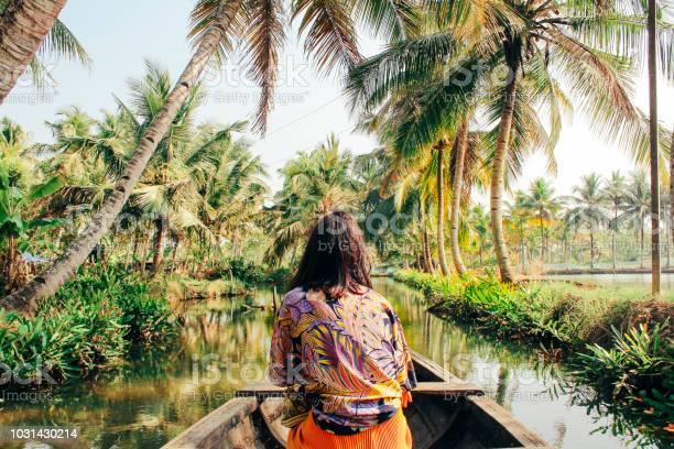 Photo of Young Woman Kayaking Through the Backwaters of Monroe Island