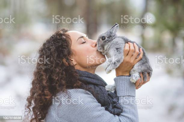 Young woman kisses her rabbit on a hike out in the snow picture id1007516538?b=1&k=6&m=1007516538&s=612x612&h=1ezhppnxanuk330p 9bnlck6acapd6qdrxlcqj liyy=