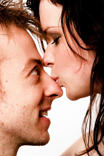 Young Woman Kissing Man On Top Of Nose Stock Photo ...