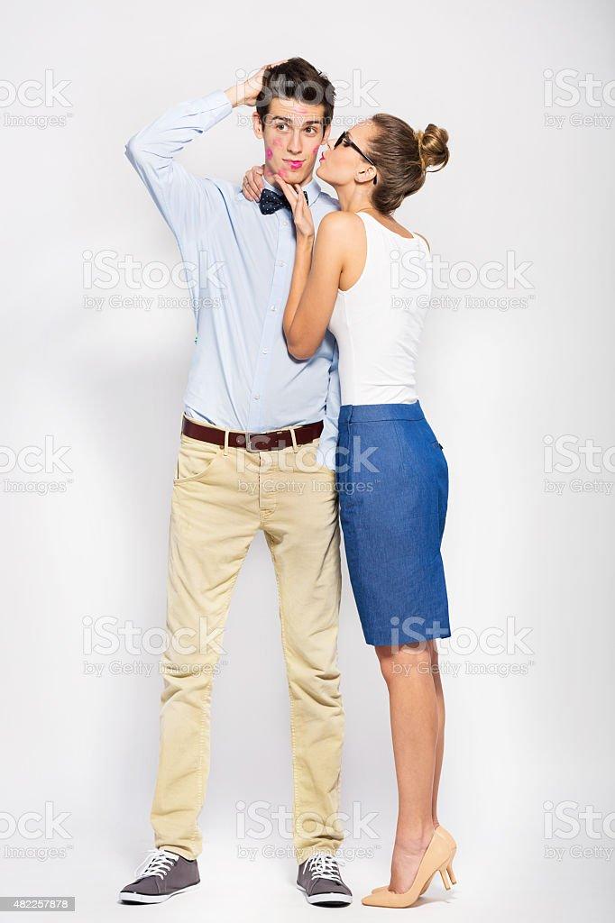 Young woman kissing man stock photo