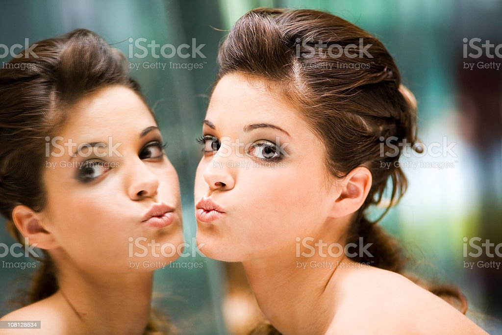Young Woman Kissing Mirror royalty-free stock photo