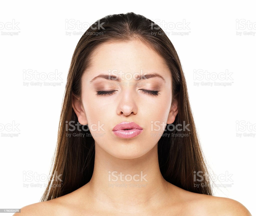Young woman kissing stock photo