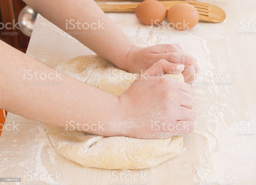 young woman kneading dough royalty-free stock photo