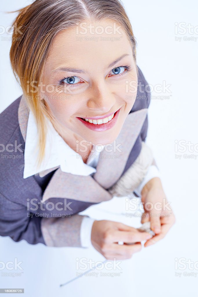 Young woman knitting with a smile royalty-free stock photo