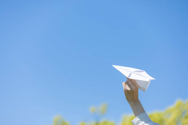 Young woman lady with handmade paper plane stock photo