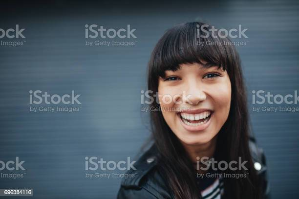 Young woman laughing against gray background picture id696384116?b=1&k=6&m=696384116&s=612x612&h=fcmvo9n4zzfoaxrvaajqyaoszslsrnhaipwdkk6 g s=