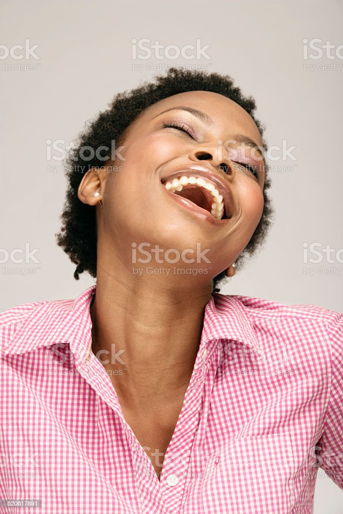 Young woman laughing, close-up stock photo