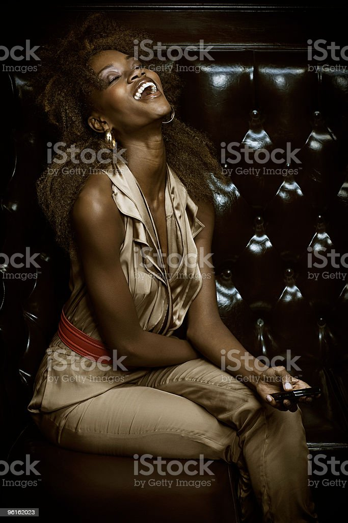 Young woman laughing in club stock photo