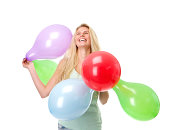 istock Young woman laughing with colorful balloons 490203569