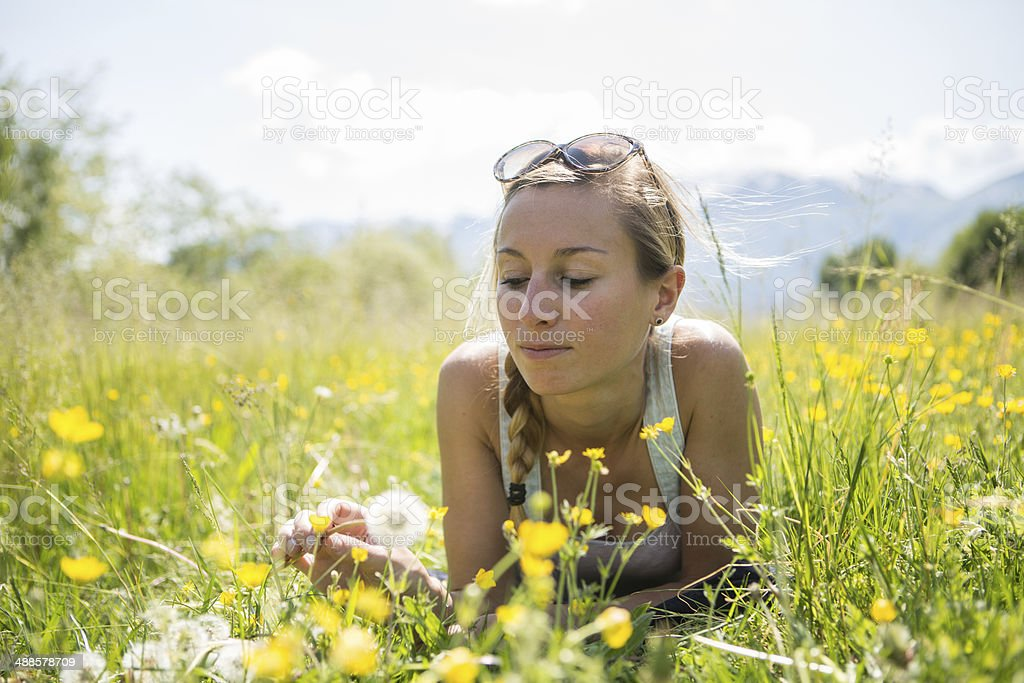 Young woman laying down in the field royalty-free stock photo