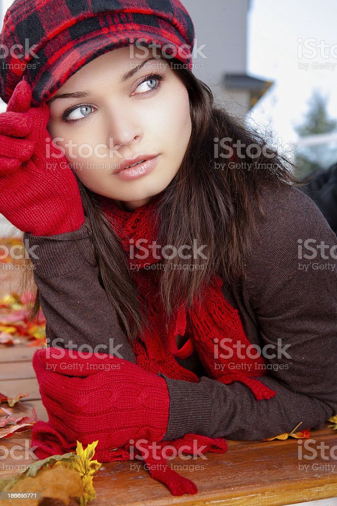 Young woman laying on autumn leaves royalty-free stock photo