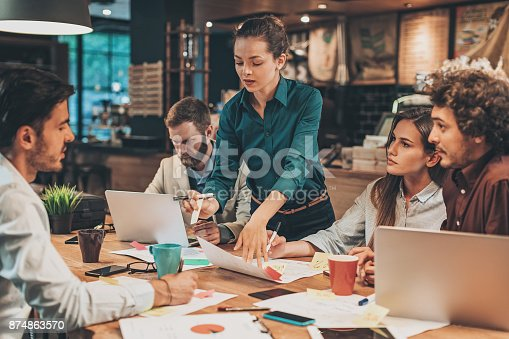 istock Young woman leading a business team 874863570