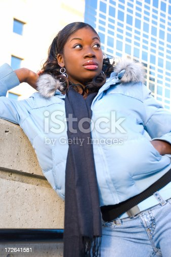 istock Young woman leaning on concrete wall. 172641581