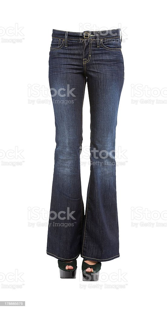 Young woman legs in bell bottom jeans and platform stilettos stock photo