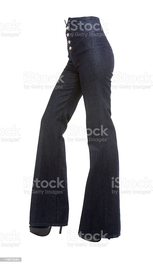 Young woman legs with bell bottom jeans and platform stilettos stock photo