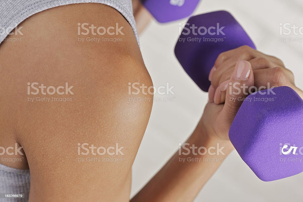 Young woman lifting dumbbells stock photo
