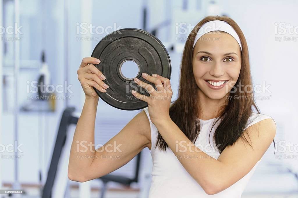 Young woman lifts weight royalty-free stock photo