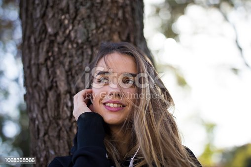 istock Young woman listening music outdoor 1068368566